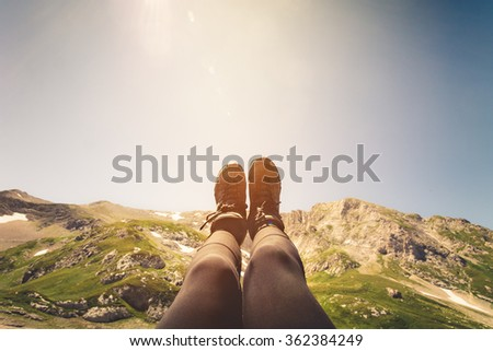 Feet Woman trekking boots relaxing outdoor Travel Lifestyle concept mountains on background Summer vacations - stock photo