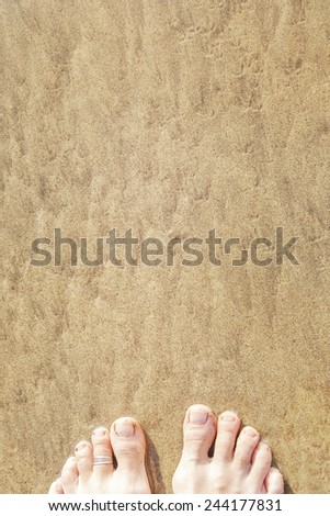 Feets at the beach. - stock photo