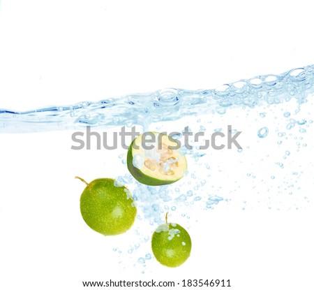 Feijoa dropped into water - stock photo