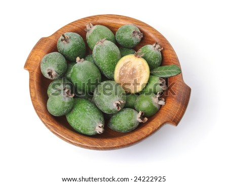 Feijoas in wooden bowl. Isolated over white - stock photo