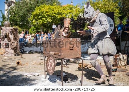 FEIRA, PORTUGAL - MAY 23, 2015: The Lost Wheels of Time performed by Serious Clowns from United Kingdom, Germany and Austria during the Imaginarius 2015 festival.