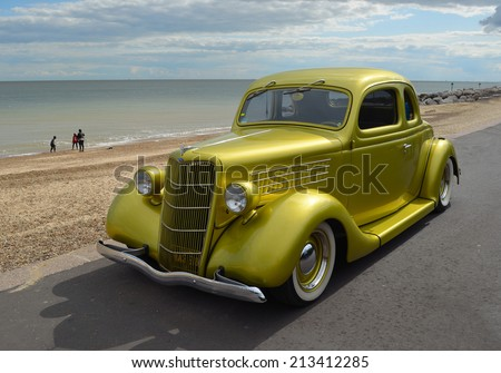 FELIXSTOWE, SUFFOLK, ENGLAND - AUGUST 23, 2014: Classic Ford in vintage car rally on Felixstowe seafront. - stock photo