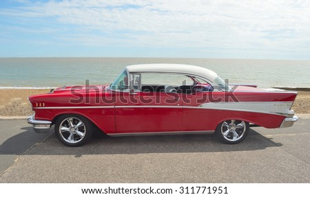 FELIXSTOWE, SUFFOLK, ENGLAND - AUGUST 29, 2015: Classic Red & White Chevrolet Belair on show on Felixstowe seafront. - stock photo