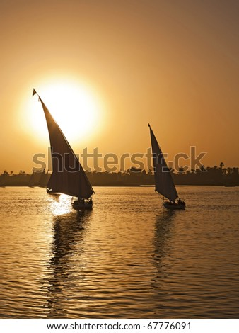 Fellucas on the River Nile sailing at sunset