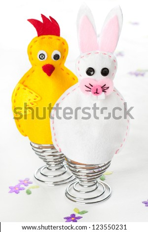 Felt handmade Easter egg warmers - stock photo