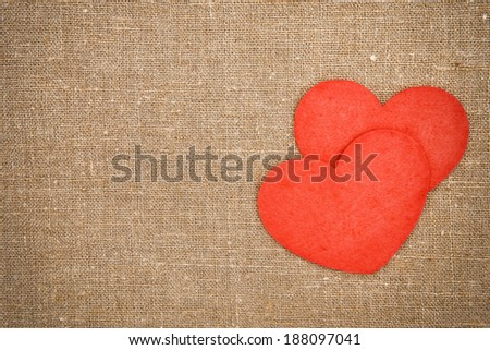 Felt red hearts on the burlap  - stock photo