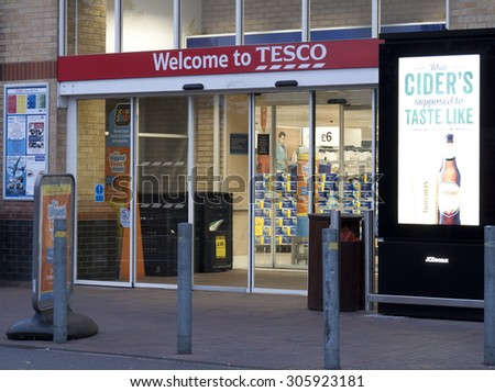 Feltham, London, Middlesex, England - August 04, 2015: Tesco supermarket main entrance to store, company founded by Jack Cohen in 1919  - stock photo