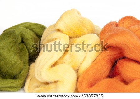 Felting activity - colorful wool slivers closeup - stock photo