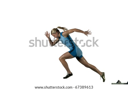 Femaile sprinter leaps from starting block. - stock photo