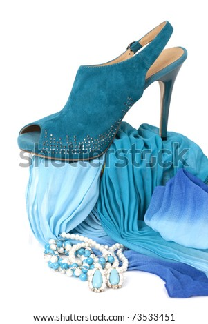 Female accessories with blue shoe isolated on white