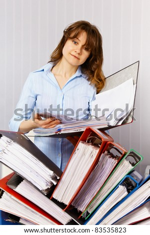 Female accountant and financial documentation - stock photo