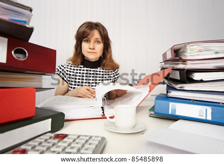 Female accountant very busy in office - stock photo