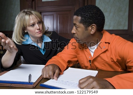 Female advocate in conversation with prisoner - stock photo