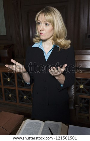 Female advocate making a speech in court room - stock photo
