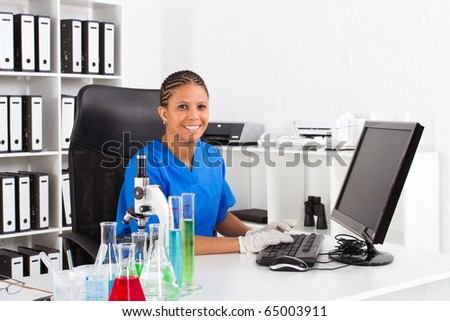 female african american scientist in lab - stock photo