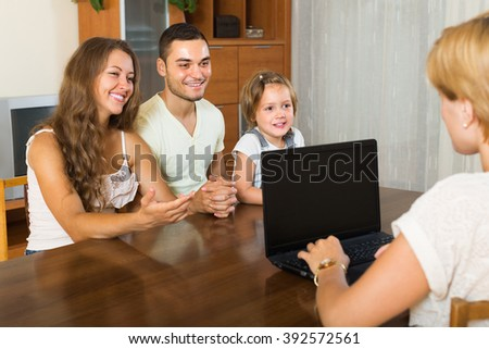 Female agent helping happy family of three to obtain insurance. Focus on girl