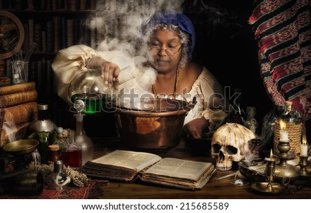 Female alchemist preparing green liquids in a smoking kettle - stock photo