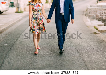 Female and male feet on the pavement - stock photo