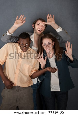 Female and male geek dance while a slick salesman waves - stock photo