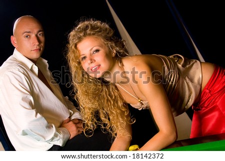 female and male models at night club interior - stock photo