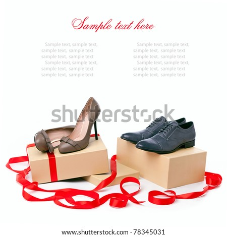 Female and male shoes on boxes with copyspace for your message - stock photo
