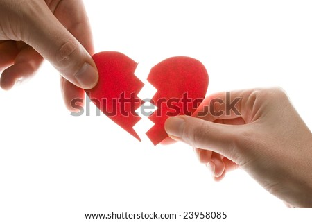 Female and man's hands with broken heart - stock photo