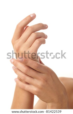 female applying cream to her hands - stock photo