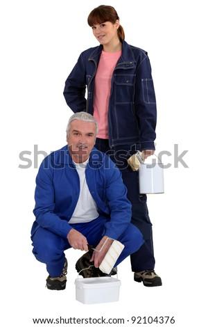 female apprentice and senior mentor - stock photo