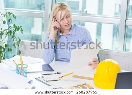 Female Architect At Work. - stock photo