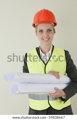 Female architect/engineer/contractor with blueprints