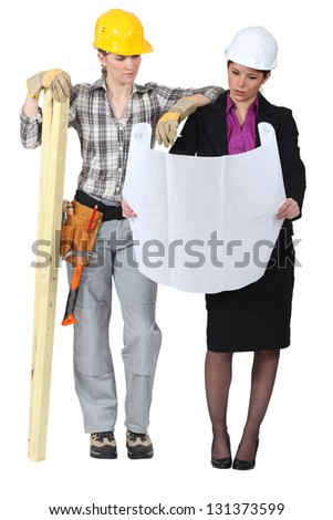 Female architect going over plans - stock photo