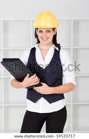 female architect holding files - stock photo