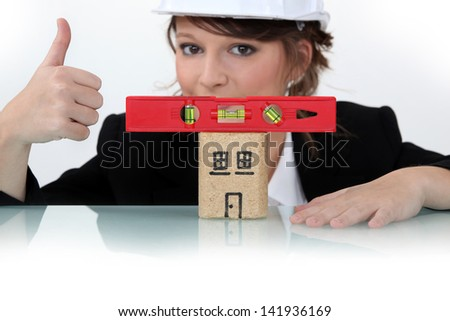 Female architect with a level house