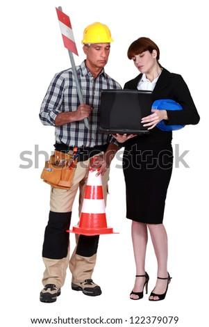 female architect with foreman isolated on white - stock photo