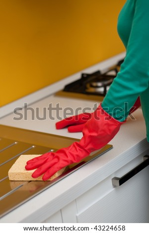 Female arms only cleaning kitchen