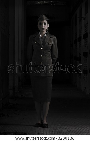 Female Army Personnel in a dark secret chamber in vintage feel - stock photo