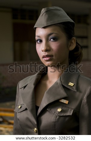 Female Army Personnel in an old barrack - stock photo