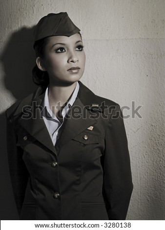 Female Army Personnel in an old barrack in vintage feel - stock photo