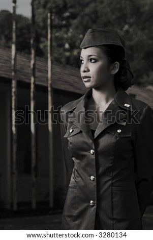 Female Army Personnel in an old barrack looking in a direction in vintage feel - stock photo