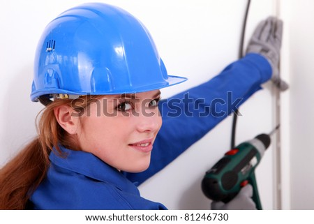 female artisan with a power drill - stock photo