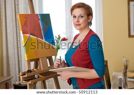 female artist painting in her living room