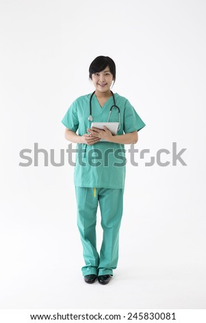 Female Asian doctor wearing a green scrubs and stethoscope. Full length portrait Isolated on white. - stock photo
