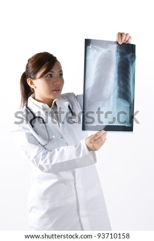 Female Asian doctor wearing a white coat and stethoscope. Isolated on white.