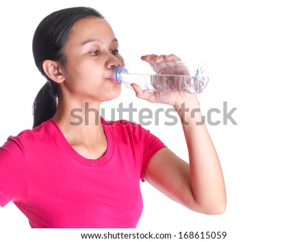 Female asian drinking a bottle of mineral water