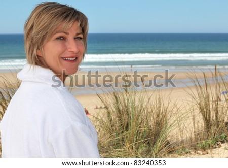 female at seaside - stock photo