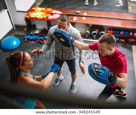 Female at the gym doing cardio kickboxing