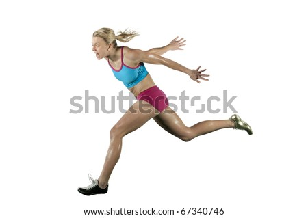 Female athlete competes in a running event. - stock photo