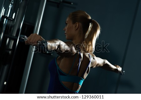 female athlete dumbbell, exercise in the fitness club - stock photo