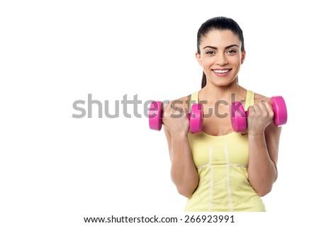 Female athlete exercising with dumbbells - stock photo