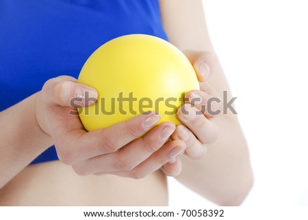 Female athlete holding shot put on a white background.